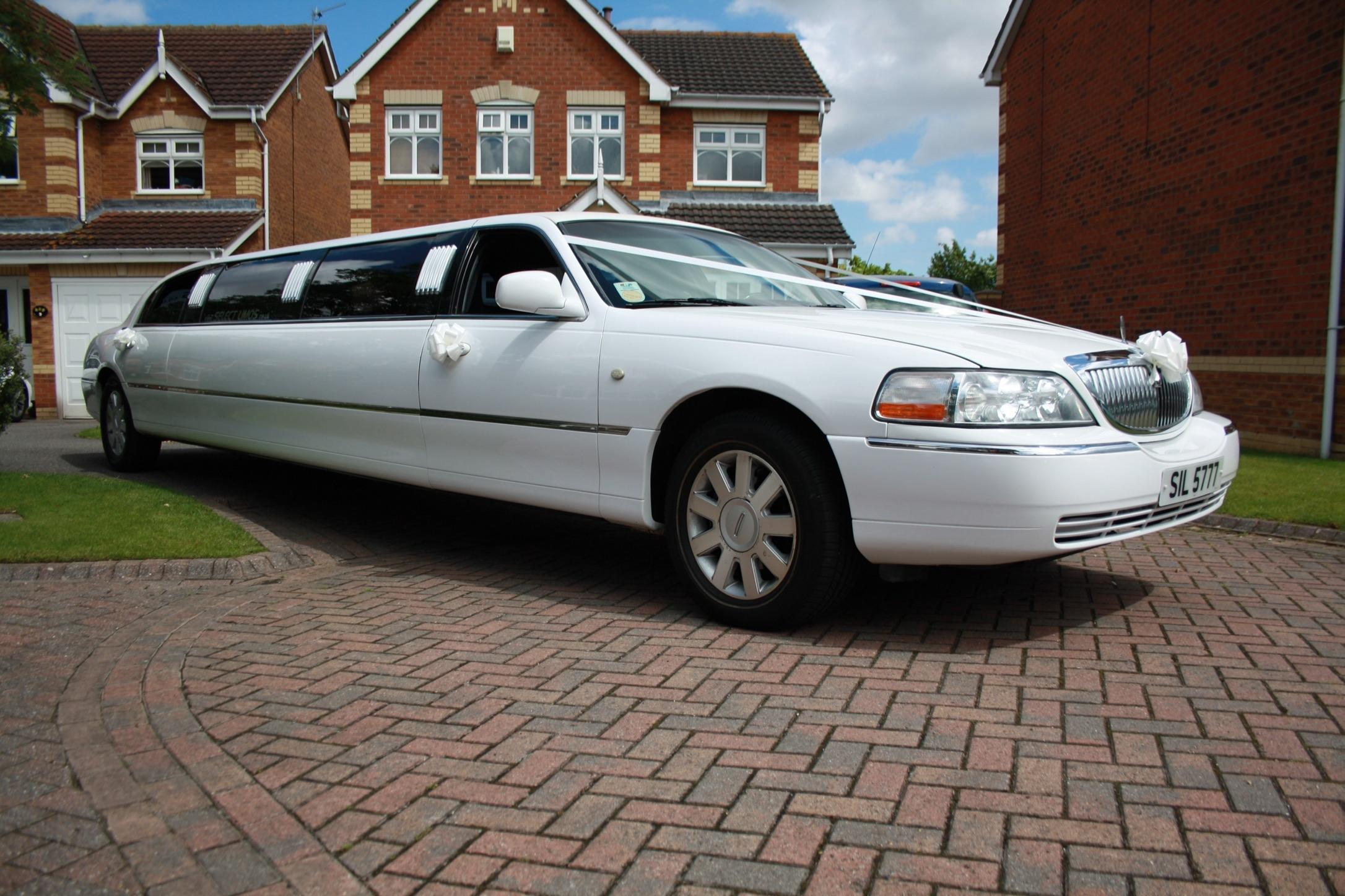 8 passenger white limousine
