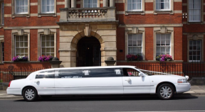 Select Limos 8 passenger white limousine